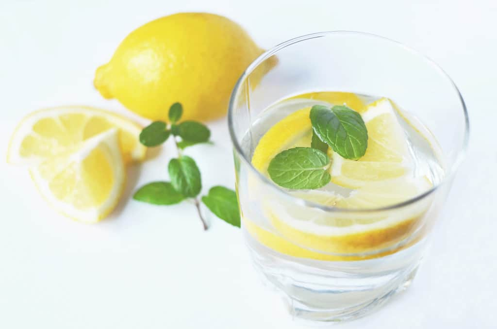 Glass of water with lemon in it, Tips for chronic chapped lipsnumber 1