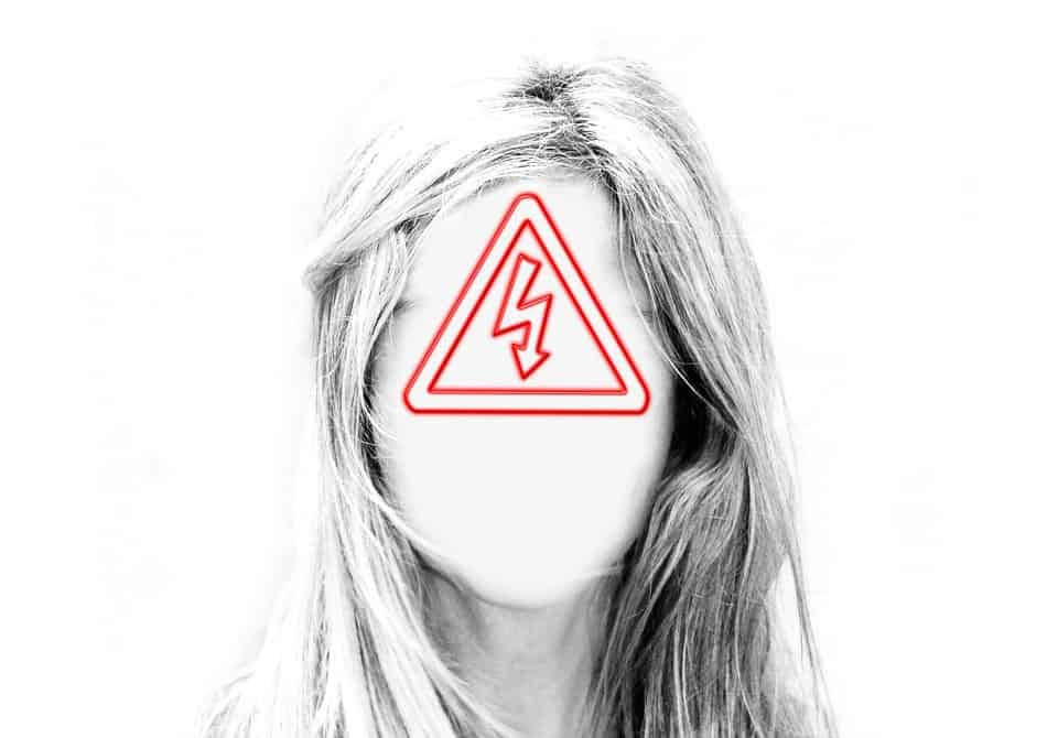 Image of a woman with a warning sign as a face
