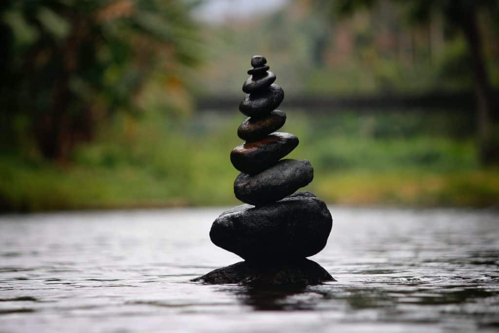 image of pebbles stacked on top of each other, signifying balance
