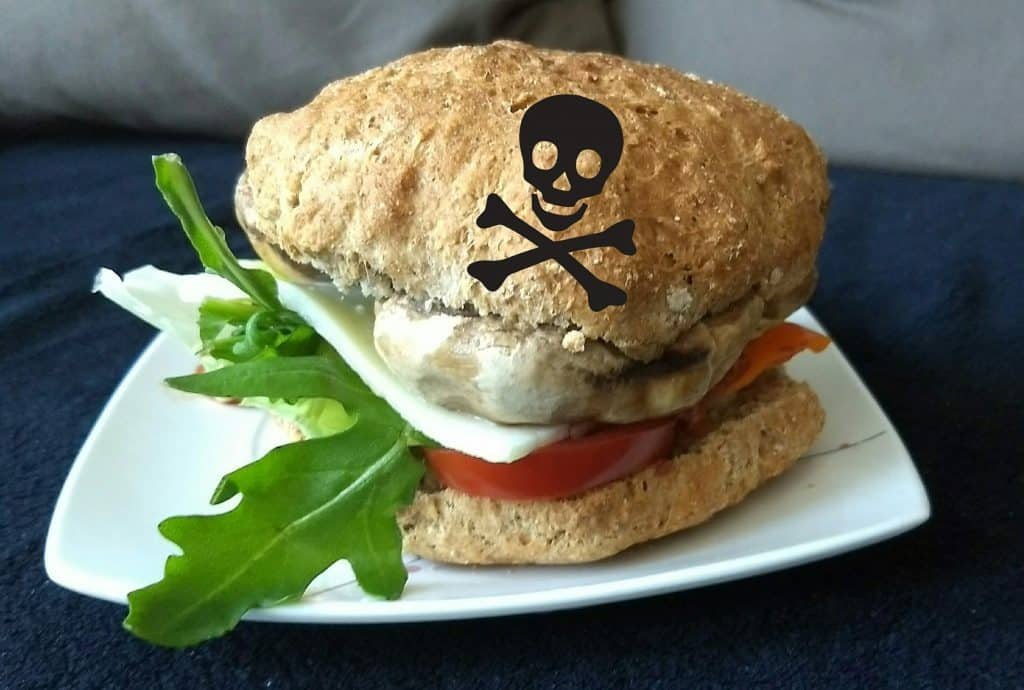 A burger with a skull to symbolise that it's a reason for adult acne.