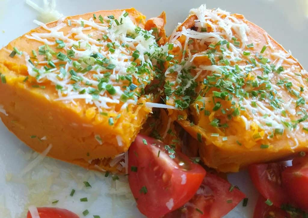 Image of the Easy sweet potato snack: Sweet potatoes with cheese, chives and tomatoes sprinkled around