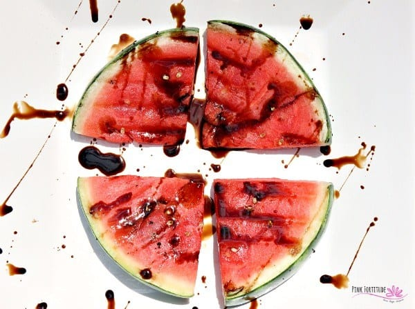 Image of a grilled watermelon with balsamic vinegar drizzled over it