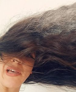 The second of the long hair struggles: long hair being blown around wildly by wind