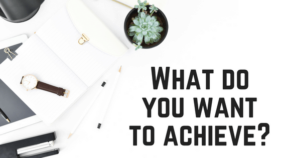 """Image of a white notebook and plant with text: """"What goal do you want to achieve?"""" written across"""