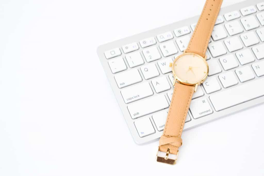 Image of a wrist watch on a white computer keyboard