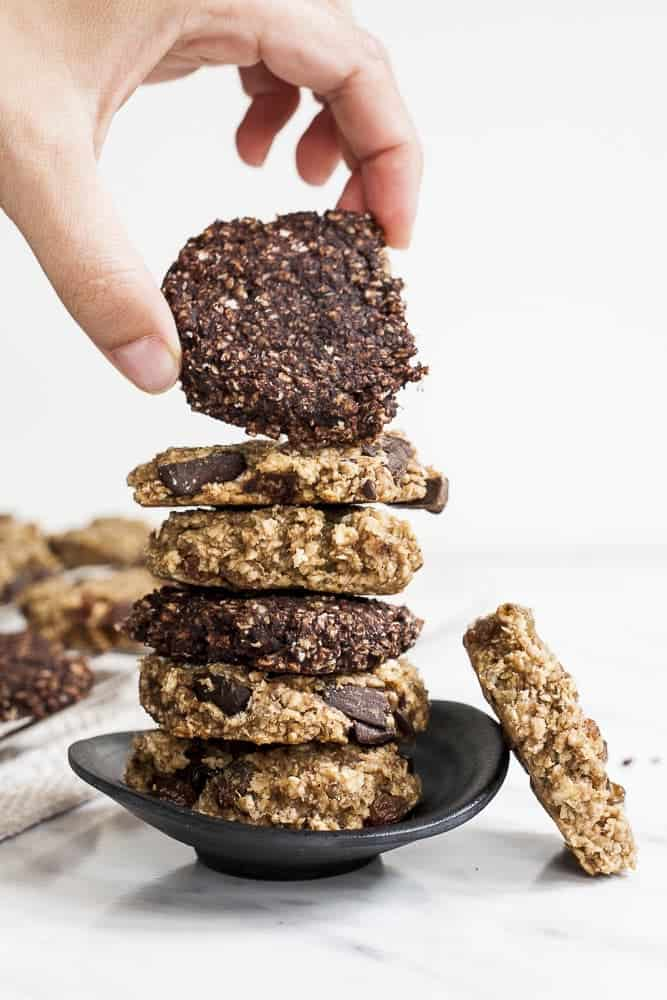 Image of brown and blonde banana peanut butter oatmeal cookies in a dark dish