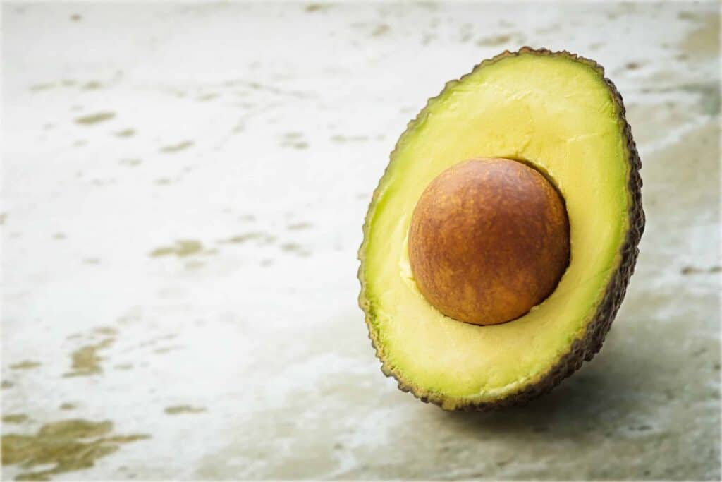 Image of half an avocado for a homemade face mask for dry skin